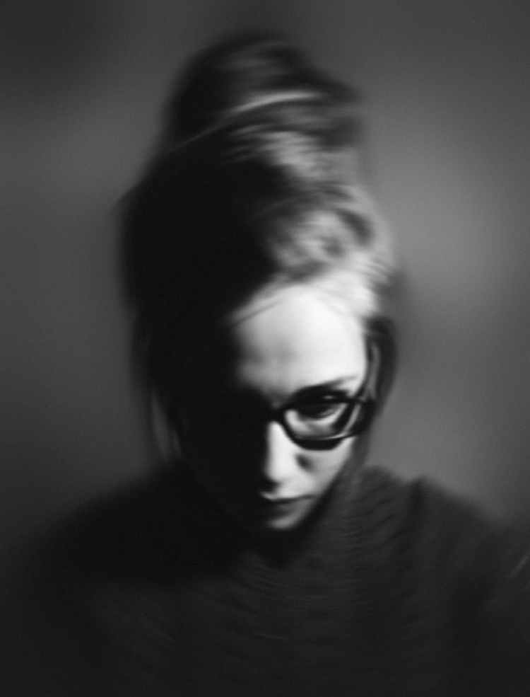 woman wearing eyeglasses in grayscale photography